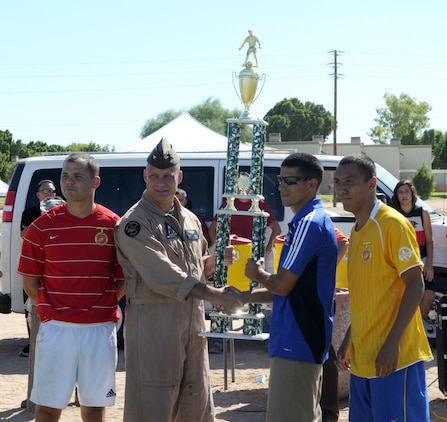 Col. Mark Werth, station commanding officer, congratulates the West Coast Regional Soccer Tournament champions from Marine Corps Base Camp Pendleton, who defeated the Marine Corps Air Ground Combat Center Twentynine Palms team in the championship game at the Marine Corps Air Station in Yuma, Ariz., Sept. 24, 2010. Two Yuma-based Marines were selected for All-Marine Soccer Team tryouts.