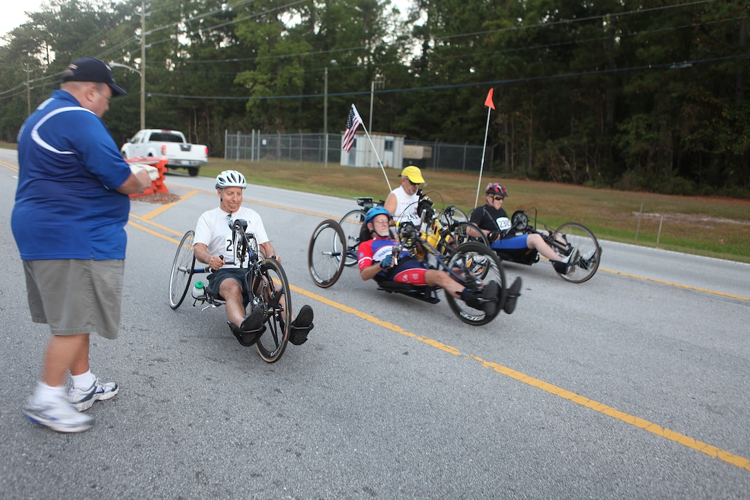 Handcyclists take off during the Marine Corps Community Services' 24th annual Marine Corps Half Marathon aboard Marine Corps Base Camp Lejeune, Sept. 25.  Handcyclists travel all around the country, competing alongside runners in events such as 10-kilometer races, half marathons and full marathons.