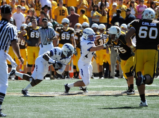 Falcons defensive back Jon Davis, left, returns an interception 23 yards during the Air Force-Wyoming match in Laramie, Wyo., Sept. 25, 2010. Davis, a Cincinnati native, also forced a fumble in the fourth quarter to crystalize Air Force's 20-14 win over the Cowboys. (U.S. Air Force photo/Dave Ahlschwede)