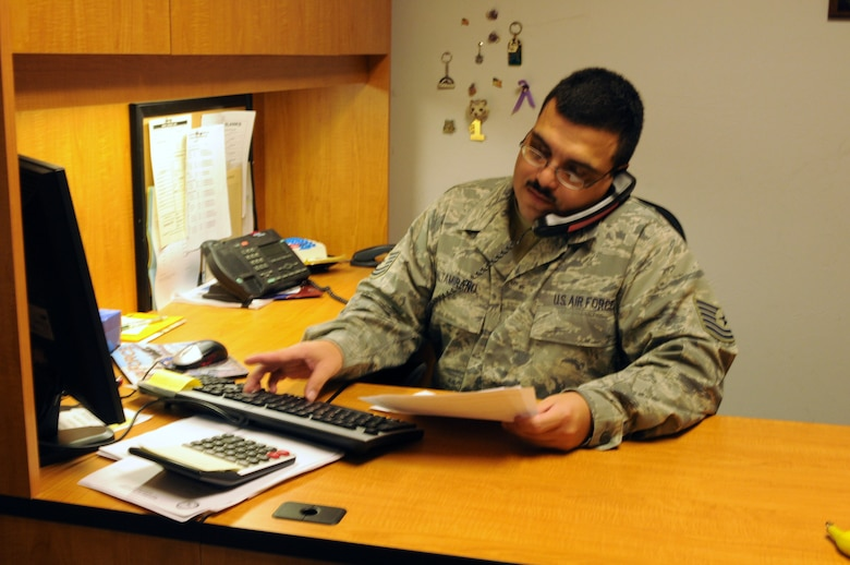 Tech. Sgt. Martin Altamirano, budget technician, works with Tech. Sgt. Jorge Sosa, resource advisor for logistics readiness squadron, over the phone Aug. 27 to balance LRS's government purchase card (GPC) account. Balancing more than 15 GPC accounts for the 162nd Fighter Wing is only one small aspect of what it takes to balance the entire wing budget. (Air Force photo by Staff Sgt. Jordan Jones)