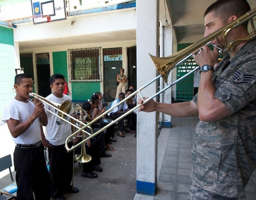 Staff Sgt. Doug Kost, New Harmony ensemble member, leads a student during a workshop in Livingston, Guatemala. The United States Air Force Band of Flight's deployed ensemble, New Harmony, reached the midpoint of its deployment to the Caribbean and Latin America in support of the Navy's Operation Continuing Promise. (U.S. Air Force photo/Maj. R. Michael Mench)
