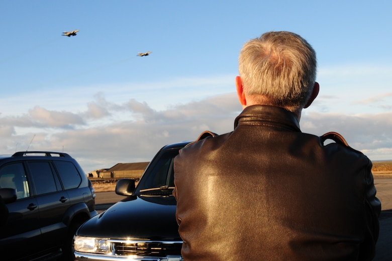 KEFLAVIK, Iceland – Gen. Roger A. Brady, U.S. Air Forces in Europe commander, watches two F-15C Eagles as they fly over during a visit to the 493rd Expeditionary Fighter Squadron here Sept. 22. The F-15 Eagles are deployed from the 48th Fighter Wing at RAF Lakenheath, United Kingdom, to support NATO's Icelandic Air Policing mission.  (U.S. Air Force photo/Senior Airman Stephen Linch)