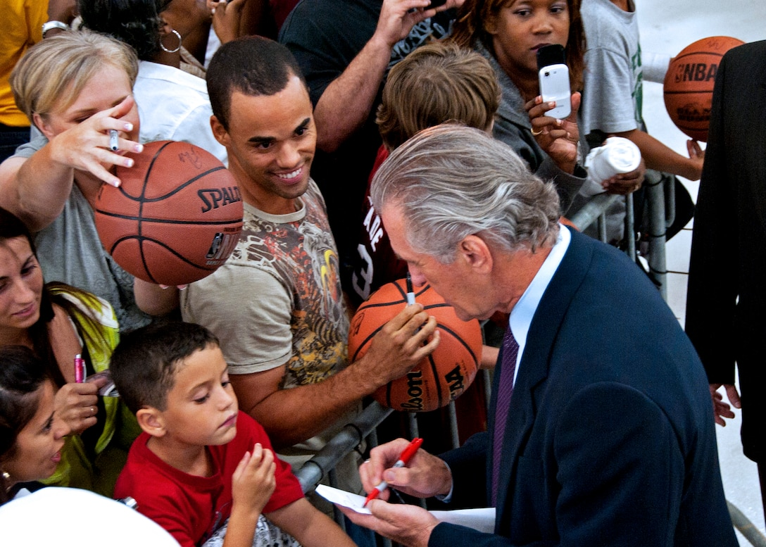 Pat Riley, Miami HEAT president and head coach, signs autographs for children during a welcome reception at an Eglin Air Force Base hangar Sept. 27. The team chose Hurlburt Field's gym as the location for their week-long training camp. In between practice times they will interact with military communities at both bases. (U.S. Air Force Photo by Samuel King, Jr.)