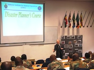 Mr Tom Marlowe, FEMA Emergency Management Training Specialist, begins DIMO's Disaster Planning course; Pretoria South Africa, November 2009.  (US Air Force Photo)