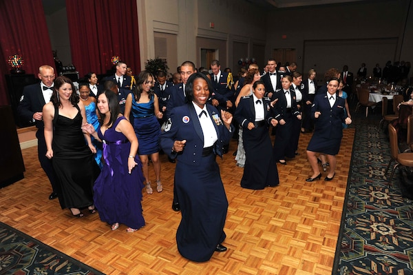 "Members of the 502nd Air Base Wing dance the ""Cupid Shuffle"" during the 502nd ABW Air Force Birthday Ball Sept. 24 at the Gateway Club. The celebration included dancing, socializing, dinner and entertainment from the Air Force Band of the West. (U.S. Air Force photo/Alan Boedeker)"