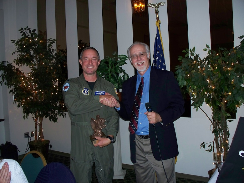 Stanley Nowak, president of the Aero Club of Buffalo presents Lt. Col. Greg Miller a C-130 pilot from the 107th Airlift Wing a bronze buffalo. The Colonel spent the evening sharing his many years of flight experience and stories with club members. The Aero Club of Buffalo comprised of aviation enthusiasts is celebrating its centennial year and is always accepting new members. Interested parties can log onto www.aeroclubofbuffalo.com for more information. (Courtesy photo)