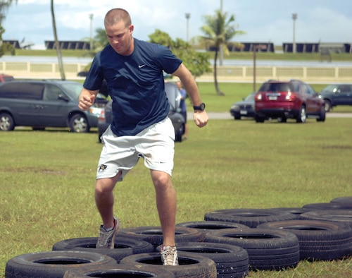Airman 1st Class Michael Martin, 36thMedical Group Aerospace Medical Technician, completes the tire obstacle course in the hopes of becoming Andersen Air Force Base's Annual Fear Factor champion Sept. 25 at Arc Light Memorial Park. The competition includes a preliminary qualifying round and three subsequent elimination rounds with a grand prize of round-trip airfare to Japan. (U.S. Air Force photo/Airman Whitney Amstutz)