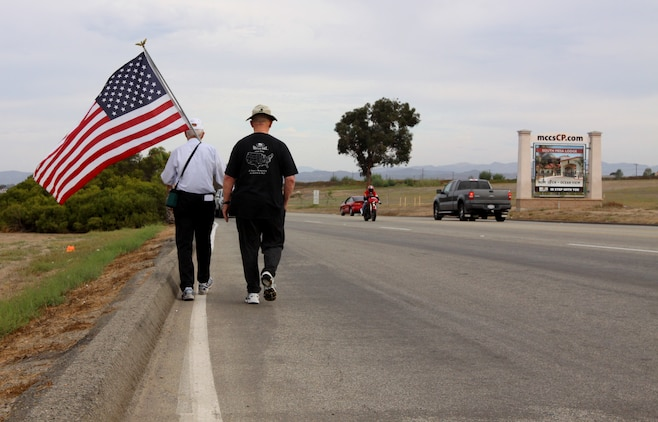 Anthony A. LoBue, better known as Tony the Vet (left), embarks on his journey near Camp Pendleton's Main Gate with his close friend Robert F. Satterfield, a retired Navy chaplain, Sept. 28. Tony is walking across America in hopes to be at Ground Zero, by Sept. 11, 2011.