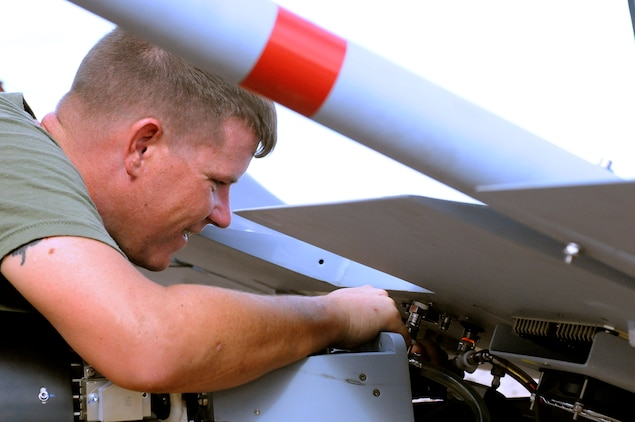Sgt. Justin Wardlow, 27 from Carbondale, Pa., Marine Unmanned Aerial Vehicle Squadron 4 unmanned aircraft mechanic, performs preflight maintenance on an RQ-7B Shadow unmanned aircraft before the squadron's inaugural flight at Auxiliary Airfield 2 in Yuma, Ariz., Sept. 28, 2010. During the flight, the squadron showcased the aircraft's reconnaissance and surveillance capabilities with a live video feed from the Shadow's onboard camera. The Yuma detachment of the Texas-based reserve squadron is the only operational component of the unit and is composed of mostly active duty Marines. The detachment, which began assembling at the Marine Corps Air Station in Yuma, Ariz., in June, has four Shadows and consists of approximately 40 Marines.