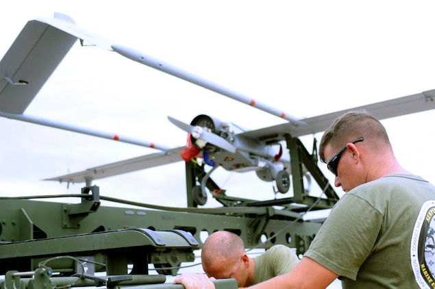Sgt. Justin Wardlow, 27 from Carbondale, Pa., Marine Unmanned Aerial Vehicle Squadron 4 unmanned aircraft mechanic, prepares the launcher for an RQ-7B Shadow unmanned aircraft before the squadron's inaugural flight at Auxiliary Airfield 2 in Yuma, Ariz., Sept. 28, 2010. During the flight, the squadron showcased the aircraft's reconnaissance and surveillance capabilities with a live video feed from the Shadow's onboard camera. The Yuma detachment of the Texas-based reserve squadron is the only operational component of the unit and is composed of mostly active duty Marines. The detachment, which began assembling at the Marine Corps Air Station in Yuma, Ariz., in June, has four Shadows and consists of approximately 40 Marines.
