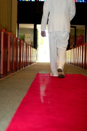 Lt. Cmdr. Carl H. Farmer, Marine Aircraft Group 13 chaplain, walks out of the chapel at the Marine Corps Air Station in Yuma, Ariz., for one of his last times, after the chaplain's retirement ceremony Sept. 28, 2010.