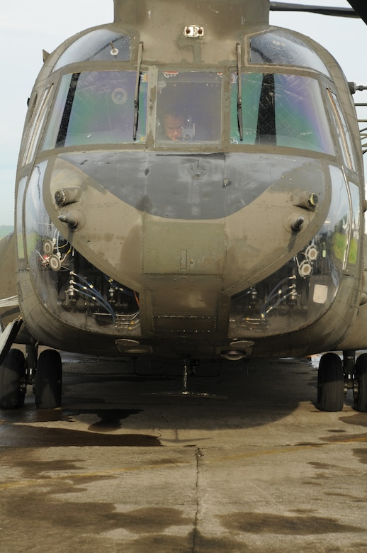 MANAGUA, Nicaragua --  Conducting a preflight inspection in the cockpit, Chief Warrant Officer Christopher Green, of the 1-228th Aviation Regiment, prepares a CH-47 Chinook helicopter for departure here Sept. 22. From Sept. 15-24,the 1-228th supported Operation Continuing Promise, which is a four-month humanitarian and civic assistance deployment. (U.S. Air Force photo/Tech. Sgt. Benjamin Rojek)