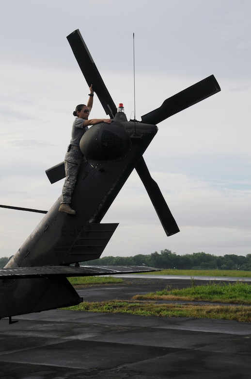 MANAGUA, Nicaragua --  Conducting a preflight inspection on the tail of a UH-60 Black Hawk, Chief Warrant Officer Denise Alonso, of the 1-228th Aviation Regiment, prepares the helicopter for departure Sept. 20 here. The 1-228th flew supplies and passengers to and from the USS Iwo Jima in support of Operation Continuing Promise from Sept. 15-24. (U.S. Air Force photo/Tech. Sgt. Benjamin Rojek)