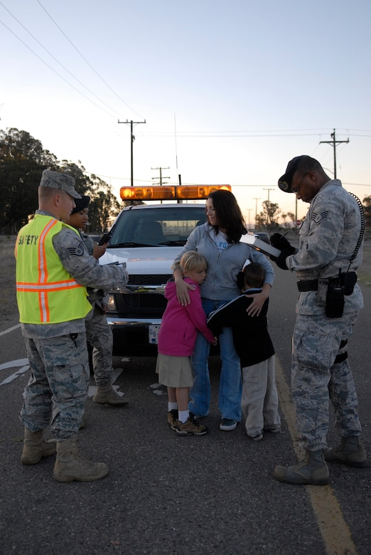VANDENBERG AIR FORCE BASE, Calif. -- Jennifer Green and her children, Gillian and Max, act as the victims of a vehicle crash during a simulated accident scenario here Monday, Sept. 27, 2010. The scenario depicted an Airman texting while driving, which caused a major vehicle accident as the result of being distracted. (U.S. Air Force photo/Senior Airman Andrew Satran)