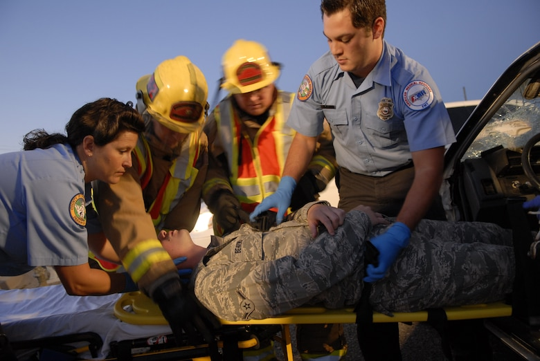 VANDENBERG AIR FORCE BASE, Calif. --  Emergency responders from the base assist an Airman in a mock vehicle accident here Monday, Sept. 27, 2010. The simulated accident stressed the importance of safe driving to prevent accidents from occurring. (U.S. Air Force photo/Senior Airman Andrew Satran)