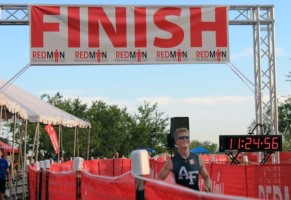 Cadet 2nd Class Nathan Betcher crosses the finish line Saturday, Sept. 25, 2010 during the Redman Triathlon in Oklahoma City.  Betcher and two other cadets raced in the event representing the Air Force Academy Triathlon Club. (Courtesy Photo)