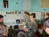 Majors Stephanie Savage and Kerry Latham demonstrate Focused Assessment with Sonography for Trauma (FAST) procedures during the Defense Institute for Medical Operations Critical Lifesaving Skills For First Responders course in Bucharest, Romania, April 2008.  (US Air Force Photo)