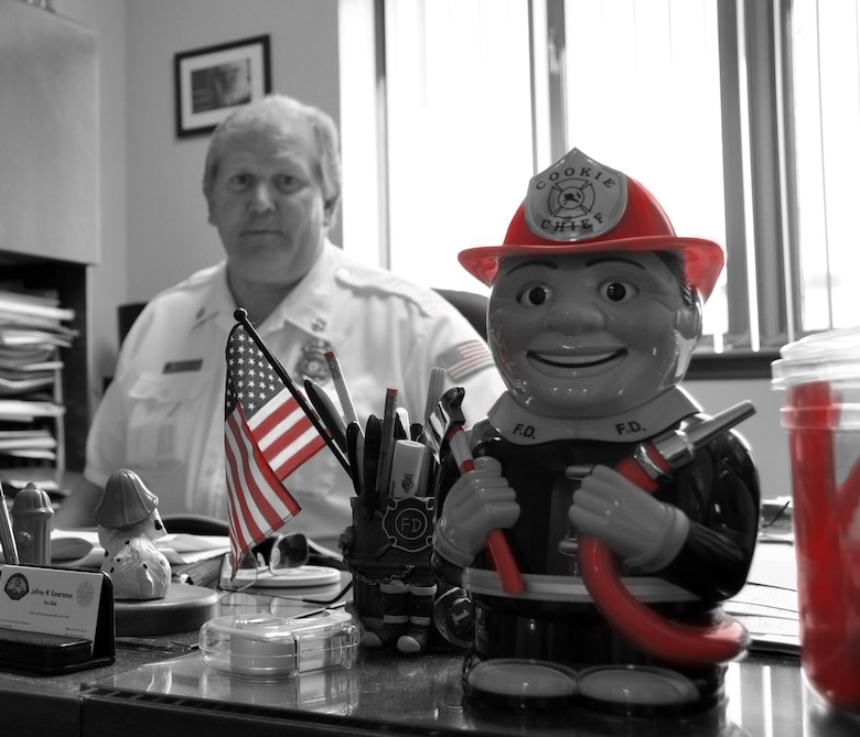 Jeffrey W. Konersman, Chief of Fire Emergency Services, sits at his desk at the March Air Reserve Base Fire Department Sept. 27, 2010.