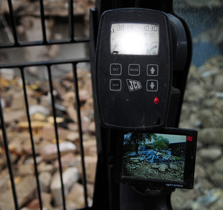 RAF MILDENHALL, England -- Equipment in the cab of a JCB shows the view from behind, so the cab driver can make sure it's safe around the entire area working on the demolition. The quality of the Airmen's quarters had deteriorated and had become surplus to requirements. Once demolition is complete, which is scheduled for January 2011, the area will be landscaped. (U.S. Air Force photo/Karen Abeyasekere)