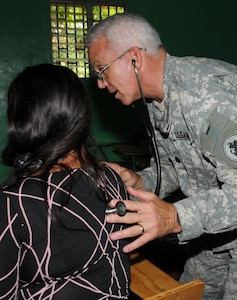 AGUA SALADA, Honduras --  Asking the patient to breathe in and out, Dr. (Lt. Col.) Michael Hoilein, the Joint Task Force-Bravo Medical Element commander, works to diagnose a woman's health issues during a medical readiness training exercise here Sept. 28. MEDEL providers worked with the Honduran Ministry of Health and military, as well as local civilian doctors, to provide primary care treatment to 419 patients Sept. 28-29 here. (U.S. Air Force photo/Tech. Sgt. Benjamin Rojek)