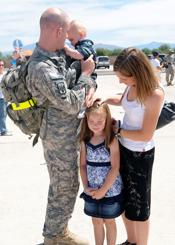 Sgt. 1st Class Robert Wilson reunites with his wife Sandra, daughter