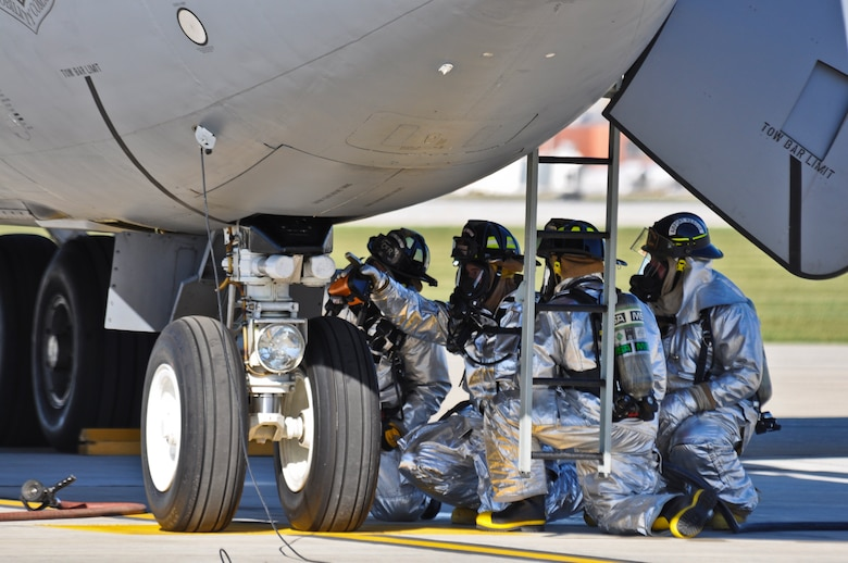 Members of the 128th Air Refueling Wing Fire Department, Milwaukee, WI respond to a preflight emergency of smoke in the cockpit of a KC-135 Stratotanker on September 30th, 2010. A member of the fire department points toward where the equipment malfunction occurred after conducting a residual heat signature scan with a thermal imaging device. The aircraft was returned to Maintenance without incident. Air Force photo by SSgt Jeremy Wilson (Released)