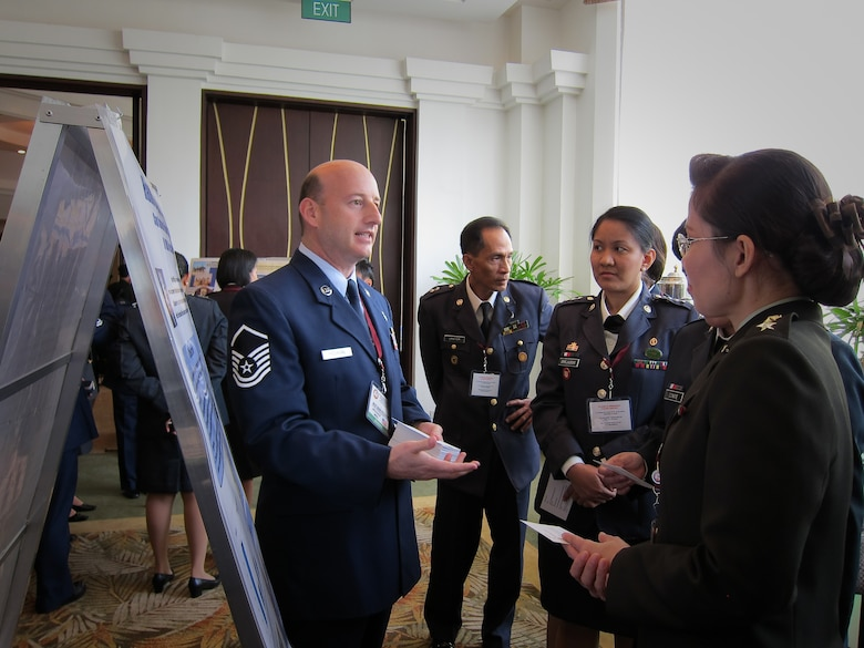 Master Sgt. Mark Picchione, 51st Medical Group, briefs Thai nurses on the Hand-hygiene Pilot Program at the Asia-Pacific Military Nursing Symposium, Mandaluyong City, Philippines. (Courtesy photo)