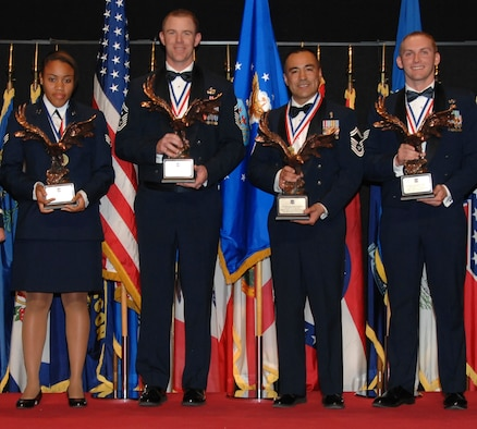 The Air Force Materiel Command's Annual Enlisted Award winners for 2010 are (from left) Senior Airman Sophia F. Joanis, Lackland AFB, Texas; Senior Master Sgt. Craig A. Neri, Wright-Patterson AFB, Ohio; Senior Master Sgt. Mario Aceves-Foncesa, Edwards AFB, Calif., and Staff Sgt. Jordan S. Bishopp, Kirtland AFB, N.M. (U.S. Air Force photo/Ben Strasser)