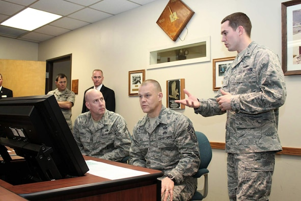 1st Lt. Stephen Lawson explains the new enlisted development tool to Chief Master Sgt. of the Air Force James A. Roy and Chief Master Sgt. Ray Guest, the Air Force's nuclear weapons career field manager, March 31, 2011, at Randolph Air Force Base, Texas. Lawson is the Air Force Personnel Center's force development chief. (U.S. Air Force photo/Tech. Sgt. Steve Grever)