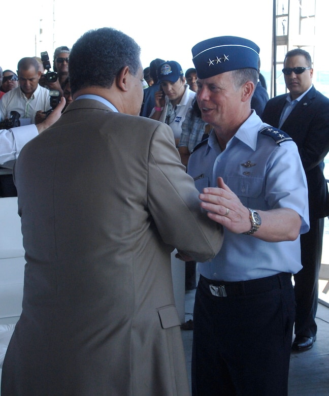Dominican Republic President Leonel Fernandez (left) greets Lt. Gen. Glenn Spears, 12th Air Force (Air Forces Southern) commander, during The Great Air Show Mar. 26 in Santo Domingo, Dominican Republic. (U.S. Air Force photo/Tech. Sgt. Eric Petosky)