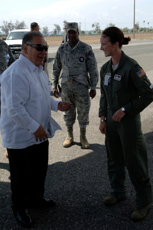 U.S. Ambassador to the Dominican Republic Raul Yzaguirre (left) speaks with 1st Lt. Jenny Caden during a tour of Air Force aircraft supporting The Great Air Show on Mar. 27. Lieutenant Caden is a C-130J pilot with the Rhode Island Air National Guard. (U.S. Air Force photo/Tech. Sgt. Eric Petosky)