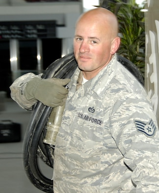 """SENDAI, Japan -- Staff Sgt. Kelsey Kent is an electronic power production craftsman forward deployed to Sendai Airport to help the Japanese recover and rebuild in the wake of the March 11 9.0-magnitude earthquake and tsunami. Other Airmen with him took to calling the Boise, Idaho native """"Clark,"""" because, as one NCO put it, """"That guy's Superman – he can do anything."""" Sergeant Kent is from the 320th Special Tactics Squadron, Kadena Air Base, Japan. (U.S. Air Force Photo/ Staff Sgt. J.G. Buzanowski)"""