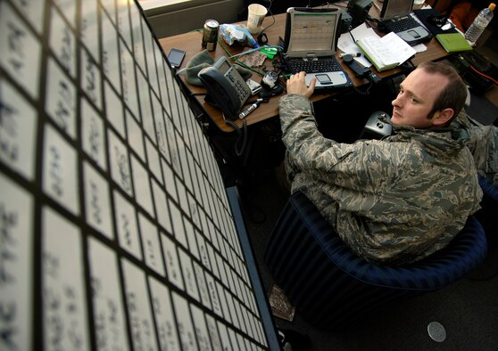 SENDAI, Japan -- Staff Sgt. Chris Sefton reviews aircraft landing schedules March 29, 2011. A team of 20 Airmen forward deployed to Sendai Airport to help the Japanese recover and rebuild in the wake of the March 11 9.0-magnitude earthquake and tsunami. Sergeant Sefton is a ground radio technician with the 320th Special Tactics Squadron, Kadena Air Base, Japan. (U.S. Air Force Photo/ Staff Sgt. J.G. Buzanowski)