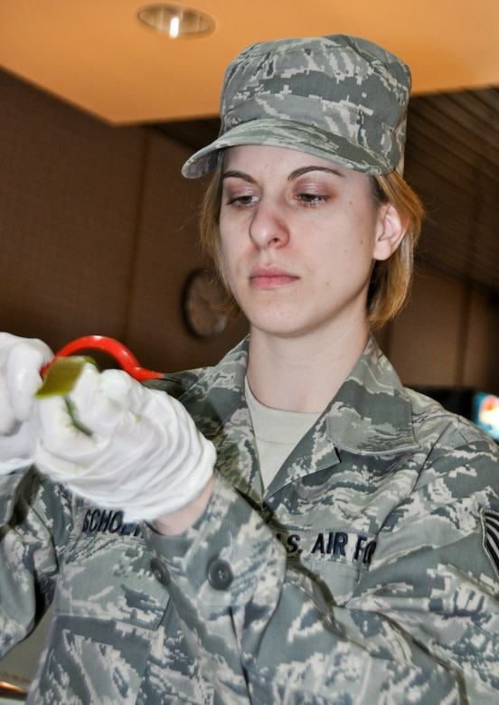 Staff Sgt. Jamie Schoewe, a 128th Air Refueling Wing services specialist, prepares a kiwi at Sijan Hall in preparation for the Sunday lunch on April 3, 2011. Schoewe was awarded the Kenneth Disney Award for her superior performance in the services squadron, and she will travel to Napa Valley, California, in September for a nine-day culinary school taught by the Culinary Institute of America at Greystone. U.S. Air Force photo by Staff Sgt. Jeremy Wilson / Released