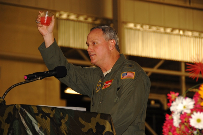 Colonel Harry D. Montgomery, Commander of the 164th Airlift Wing, raises a toast during the Combat Dining-In
