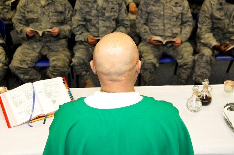 Chaplain (Maj.) Mike Martinez conducts Catholic mass for Arizona Air National Guardsmen assigned to Tucson's 162nd Fighter Wing during a Unit Training Assembly weekend. (U.S. Air Force photo/Tech. Sgt. Hollie Hansen)