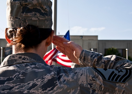 A female first sergeant salutes the flag during a retreat ceremony conducted solely by female Airmen March 31 at Eglin Air Force Base, Fla. The flight and flag detail team were made up of women from around the base. The ceremony closed out Women's History Month on base.  (U.S. Air Force photo/ Samuel King Jr.)