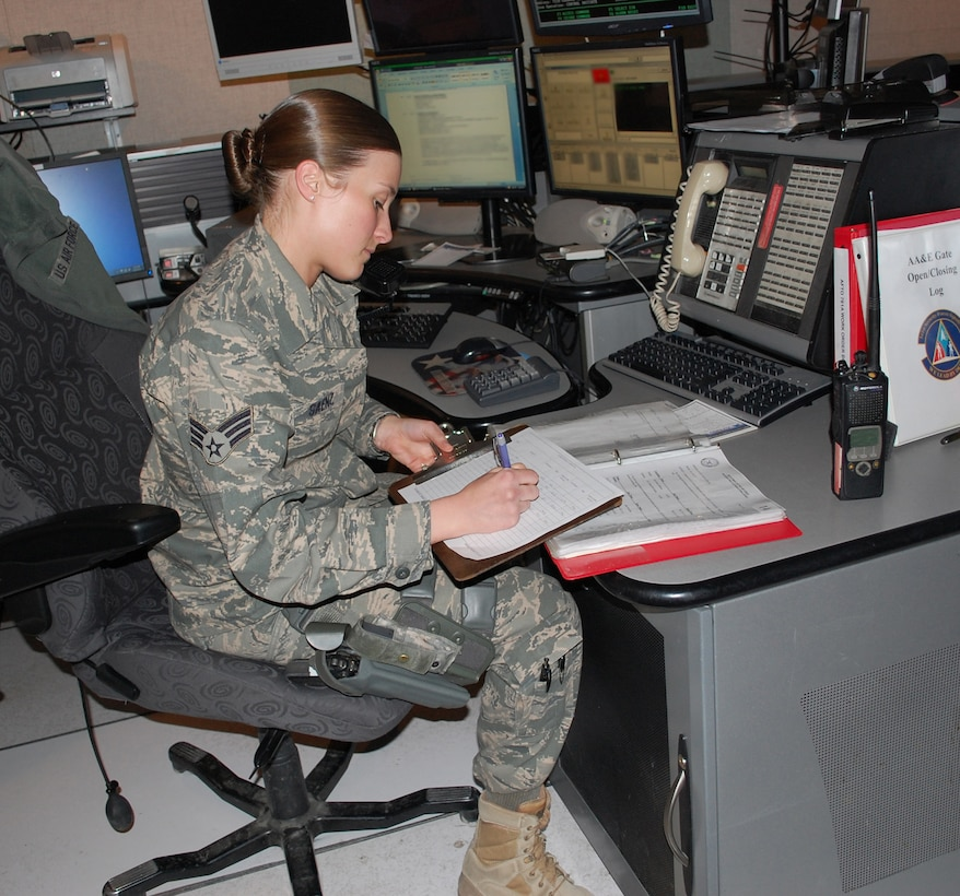 Senior Airman Tonya Saenz completes some of her daily paperwork. She is one of only three Airmen selected to work with the noncommissioned officers that staff the BDOC. She was also selected as this year's 341st Missile Wing Airman of the Year. (U.S. Air Force photo/Valerie Mullett)