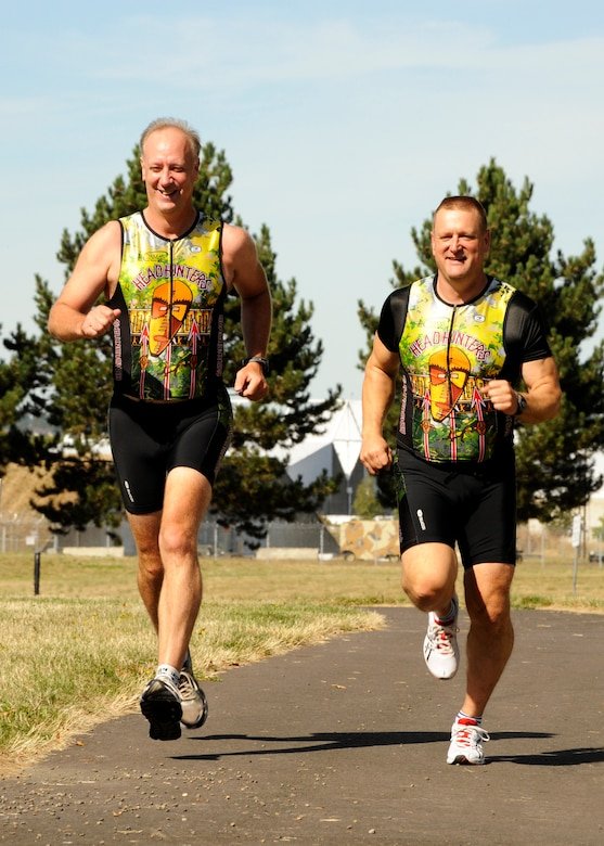 Running along the fitness trail at the Portland Air National Guard Base, U.S. Air Force Master Sgts. Jeff Macey and Brian Cummins stretch out their legs for an afternoon workout.