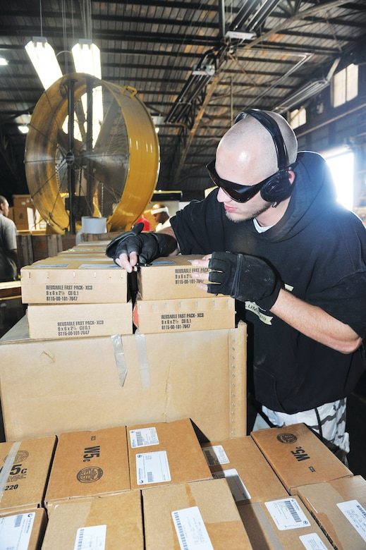 Chad Annis, Georgia Industries for the Blind, inspects boxes which have been repaired. U. S. Air Force photo by Tommie Horton