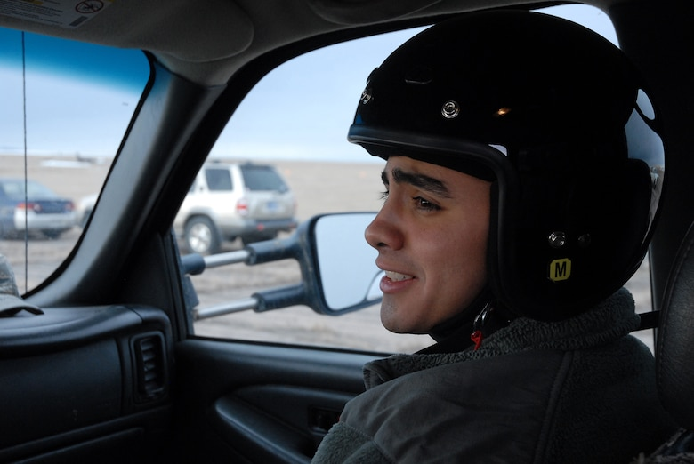 Airman 1st Class Daniel Garcia,341st Maintenance Group Facility Maintenance Section team member listens to instructions given by Staff Sgt. James Broderick, 341st MXG driving instructor near on the gravel road course March 15. (U.S. Air Force photo/Staff Sgt. Dillon White)