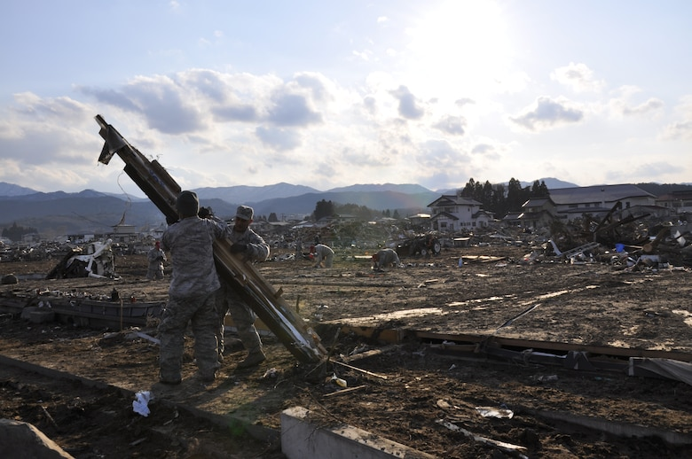 photo essay military volunteers assist tsunami struck village  photo essay military volunteers assist tsunami struck village > misawa air base > article display