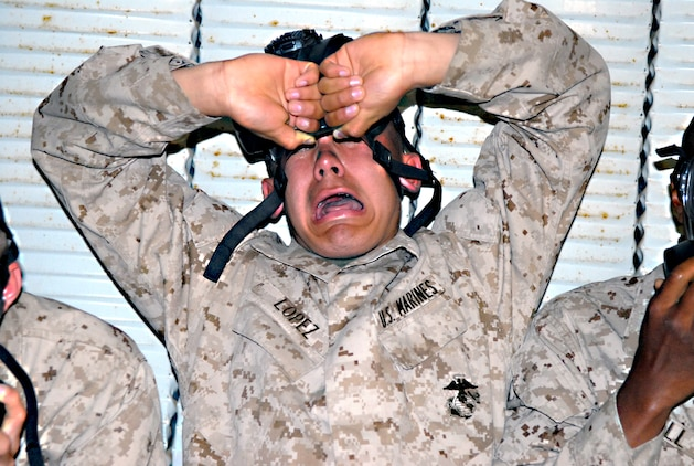 A recruit from Company G reacts to the 2-chlorobenzalmalononitrile also known as CS gas, a defining component of tear gas, after breaking the seal of his mask in the confidence chamber April 4. The confidence chamber simulates the type of environment a Marine may encounter in a chemical, biological, radiological and nuclear warfare situation. A recruit from Company G reacts to the 2-chlorobenzalmalononitrile also known as CS gas, a defining component of tear gas, after breaking the seal of the mask.