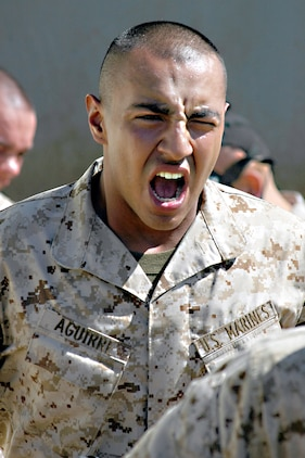 Recruit Nicholas A. Aguirre, Company G, yells out a war cry as he runs out of the confidence chamber April 4. Aguirre and the other recruits were subjected to the effects of CS gas to familiarize them with their gear and the symptoms they may encounter in combat.
