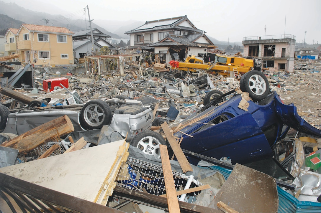 Four days later:  In Otunato, Japan, boats and cars alike were tossed into buildings and buried in rubble during the March 11 earthquake and tsunami.  (U.S. Air Force photo/Technical Sgt. Daniel St. Pierre)