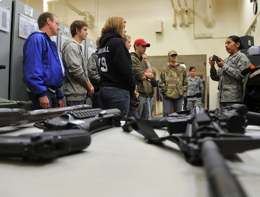 OFFUTT AIR FORCE BASE, Neb. -- Staff Sgt. Tracy Howard, NCO in charge of the 55th Security Forces armory, displays a 30-round magazine and explains how the magazine is utilized to eight students from St. Mary's High School (Kansas) in the armory here March 24. The students visited the armory as part of a base tour. U.S. Air Force Photo by Jeff W. Gates