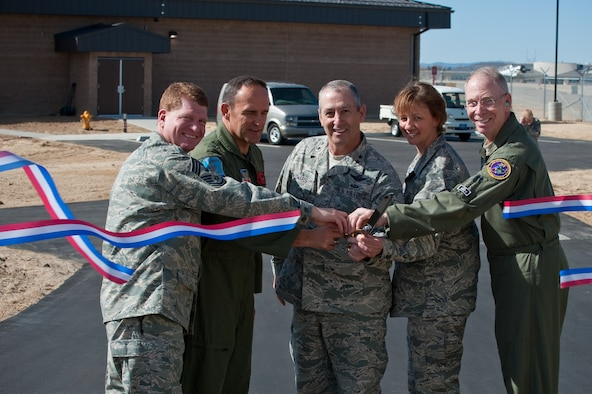 (From left to right) Chief Master Sgt. John Criswell, 140th Wing Command Chief, Brig. Gen. Trulan Eyre, 140th Wing Commander, Maj. Gen. H. Michael Edwards, Colorado Adjutant General, Chief Master Sgt. Annadele Kenderes, State Command Chief Master Sgt. and Brig. Gen. William Hudson, Colorado Air National Guard Commander cut the ribbon and officially open the new 140th Alert Crew building 911 April 2. (U.S. Air Force photo/Master Sgt. John Nimmo, Sr.) (RELEASED)