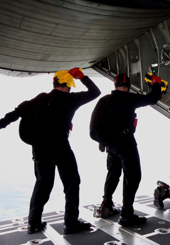 Members of the U.S. Army Special Operations Command Parachute Demonstration Team wait to jump as their aircraft approaches the jump site. (Photo courtesy/U.S. Army)
