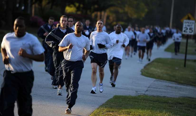 Members of Joint Base Charleston pace themselves as they near the three-quarter-mile mark of the Commander's Fitness Run April 1, 2011, on Joint Base Charleston, S.C. This month's fitness run was held to raise awareness of both sexual assault and rape. (U.S. Air Force photo/Senior Airman Timothy Taylor)(Released)