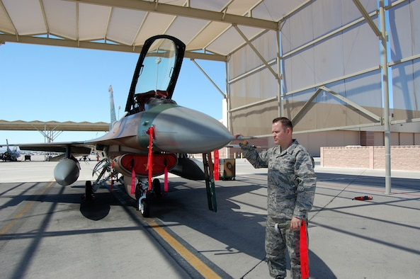 NELLIS AIR FORCE BASE, Nev. -- Tech. Sgt. Jonathan Jundt, 926th Aircraft Maintenance Squadron avionics craftsman, conducts an inspection of a pitot probe for the air data system on an F-16 Aggressor aircraft here April 1. (U.S. Air Force photo/Capt. Jessica Martin)